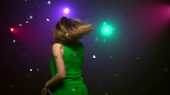Cover Image for Woman in Green Dress Dancing at Party, Close-up, Slow Motion