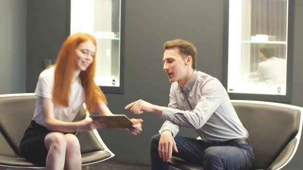 Thumbnail for Attractive Girl Manager Is Negotiating with the Buyer in Car Salon