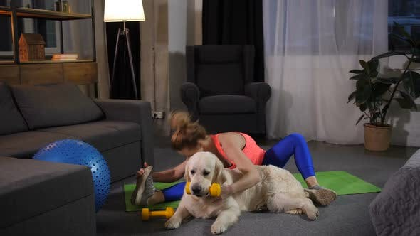 Thumbnail for Fitness Female Stretching with Retriever Dog