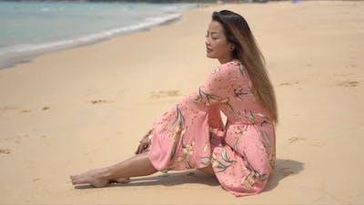 Barefoot Ethnic Woman Sitting on Beach
