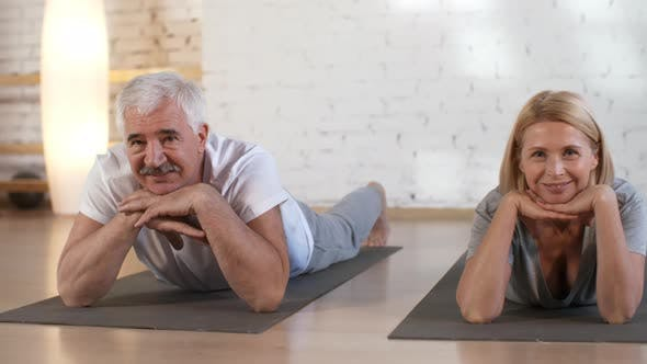 Cover Image for Happy Caucasian Couple Relaxing after Yoga Class