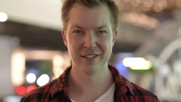 Thumbnail for Young Handsome Hipster Man Smiling In The City At Night