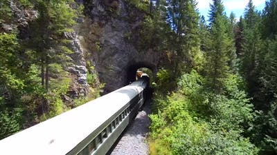 Flight Above Train Travelling Through Tunnel