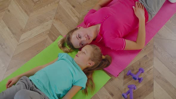 Overhead Portrait of Mom with Girl Relaxing After Training