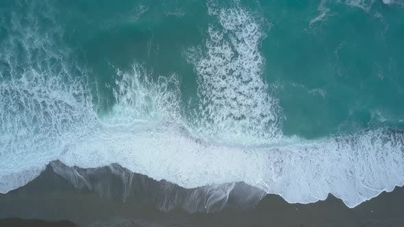 Thumbnail for Aerial Top View Turquoise Sea Waves From Bird's Eye View, Ocean Waves Reaching Shore and Splashing