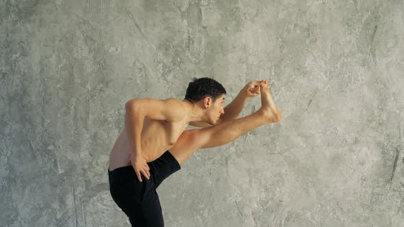 Thumbnail for Sportsman doing sport exercise bending in variation of