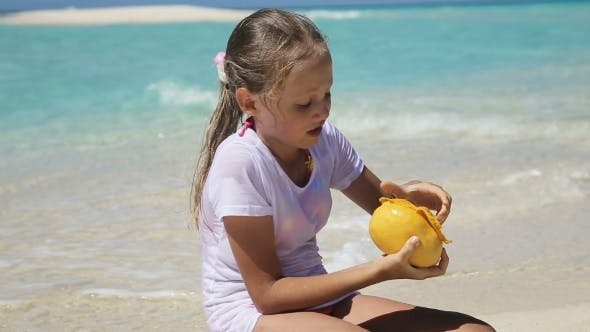 Thumbnail for Young Girl On The Beach Eating Mango Fruit