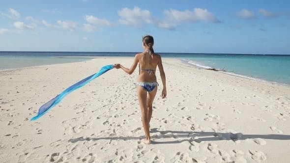Thumbnail for Girl With Silk Fabric Walking Along The Beach