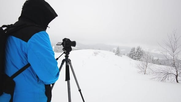 Cover Image for Photographer In Winter Mountain