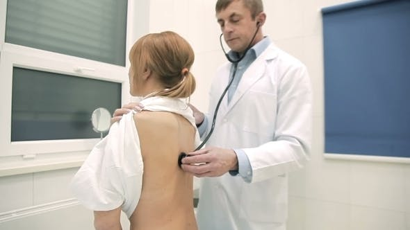 Thumbnail for Doctor Checking Patient's Lungs Using Stethoscope