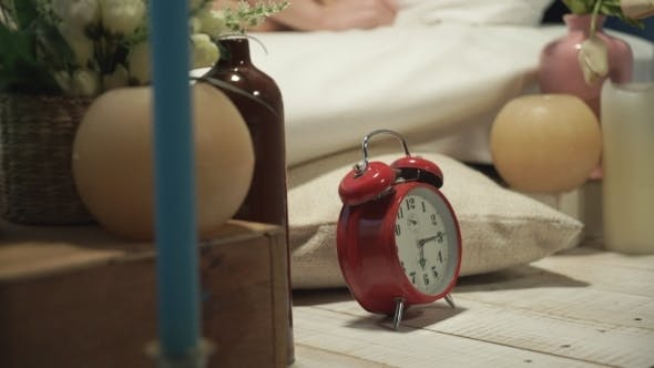 Thumbnail for The Woman Turns Off The Alarm And Hides It Under The Pillow