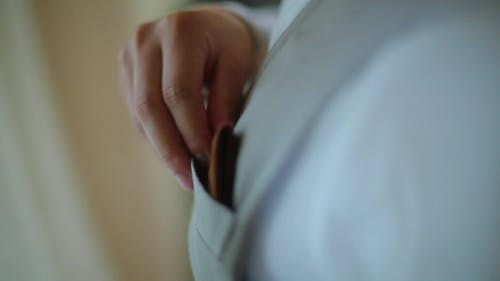 The Guy Puts The Handkerchief In His Pocket Vest