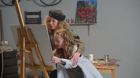 Thumbnail for Girl Puts Canvas on an Easel, Woman Explains How To Draw