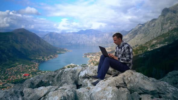 Thumbnail for Guy Using Laptop Mountain Landscape in Summer