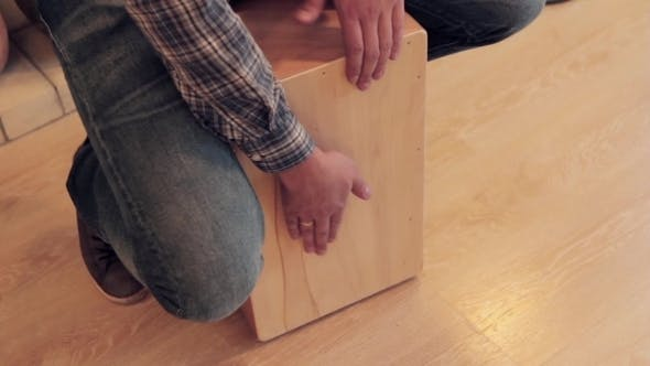 Thumbnail for Musician Beat Off a Rhythm On Wooden Box Like Drummer