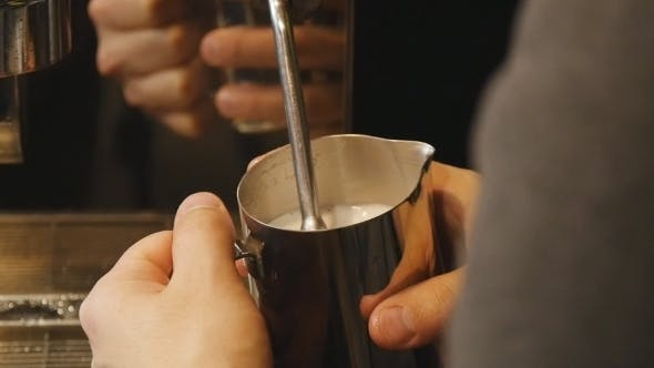 Thumbnail for Barista Steaming Milk For a Latte Or Cappuccino