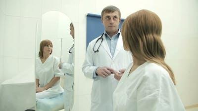 Upset Woman On a Medical Examination