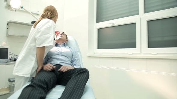 Thumbnail for Doctor Examining Male Patient