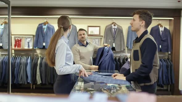 Thumbnail for Young Man Asking for Advice on Jacket at Checkout
