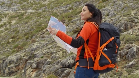 Thumbnail for Young Woman Out Hiking Checking a Map