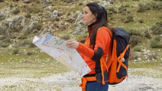 Thumbnail for Young Woman Hiking Using a Map