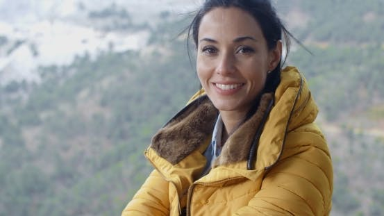 Thumbnail for Smiling Young Woman Hiking In The Mountains