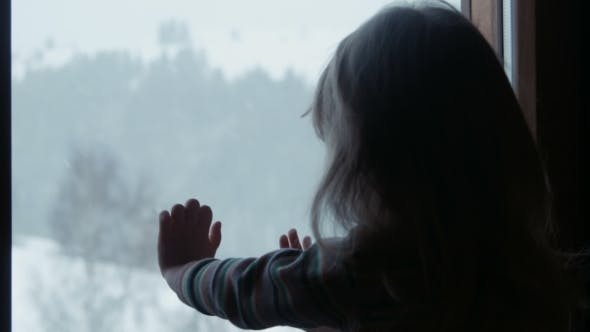 Thumbnail for Little Cute Girl Behind Window In Winter