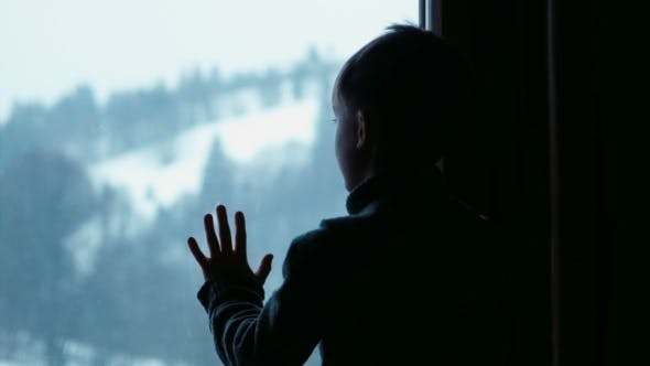 Thumbnail for Boy Behind Window In Winter