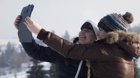 Thumbnail for Girlfriends Do Selfie on The Mountain Using Tablet