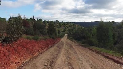 Driving On a Dirt Road In Countryside