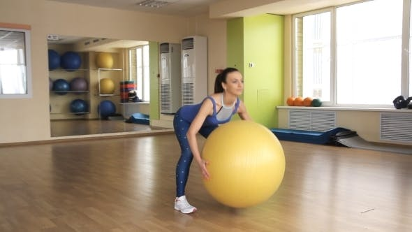 Thumbnail for Young Athletic Woman Trains In Gym