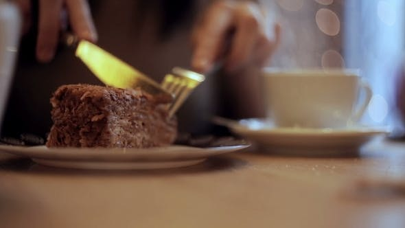 Thumbnail for Girl Eating Cake And Drinking Coffee In Cafe