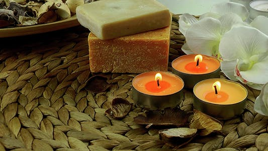 Thumbnail for Candles Soaps and White Orchid on Wicker