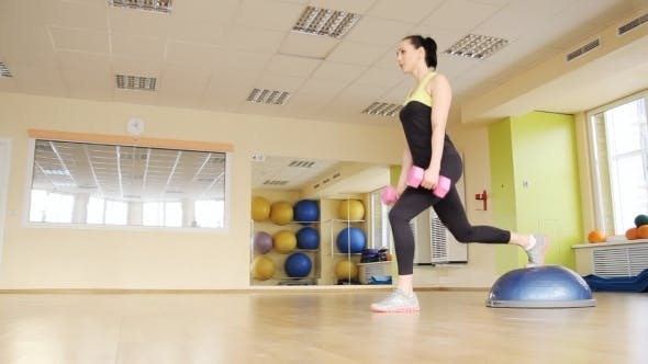 Thumbnail for Athletic Woman Trains At The Gym