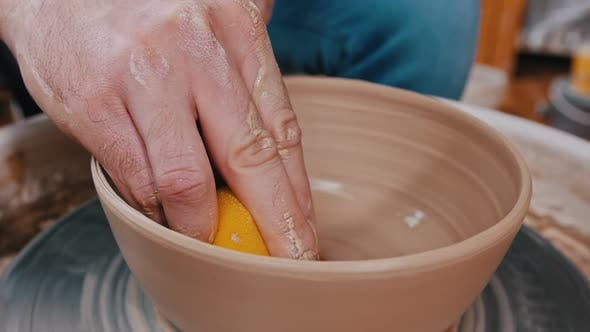 Thumbnail for Man Potter Working with a Clay Figure Using a Sponge