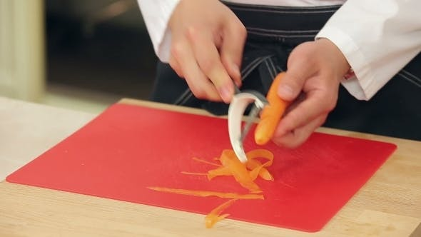 Cover Image for Chef Is Peeling And Slicing Carrots