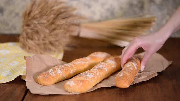 Freshly Baked French Baguettes on Wooden Table