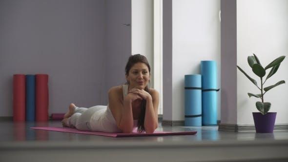 Thumbnail for Happy  Woman Lying On The Yoga Mat