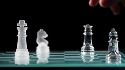 Checkmate With Transparent Figure With Three Other Figures
