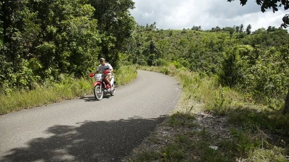 Thumbnail for Man Driving a Motorcycle On Mountain Road
