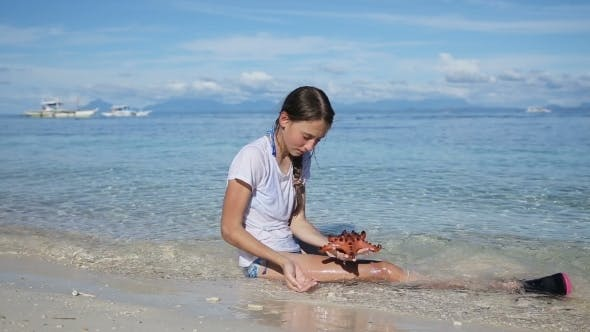 Thumbnail for Girl Playing With a Starfish