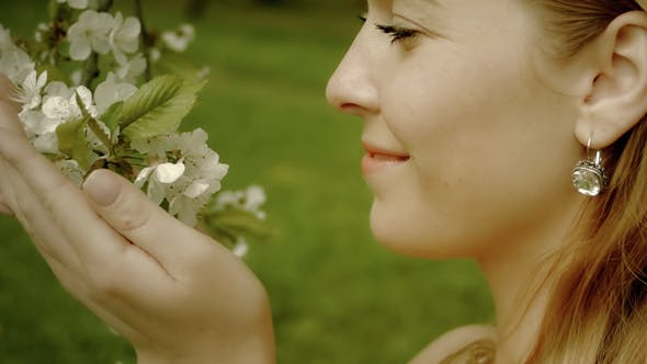 Thumbnail for Happy Woman Touching White Flowers