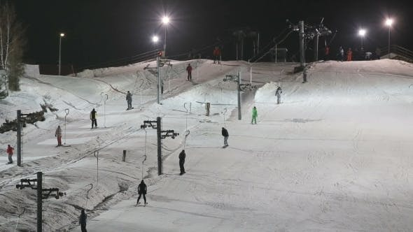 Thumbnail for Skiers And Snowboarders On a Ski Lift