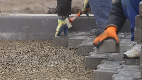 Thumbnail for Worker Puts Sidewalk Tile