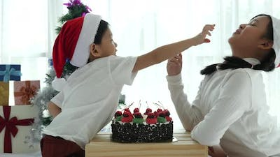 Happy Asian Children In Christmas Hat With Christmas Cake