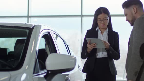 Thumbnail for Auto Saleswoman Working with Client at Dealership