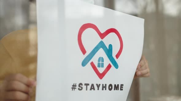 Thumbnail for Child Holding a Picture with Title Stay Home.