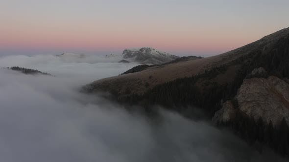 Aerial Views Over Mountains And Clouds