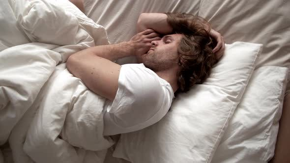 Top View of Man Sleeping in Morning