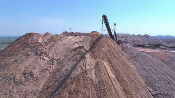 An Industrial Spreader in the Process of Work. The Process of Pouring Rock Piles